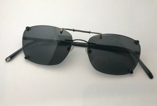 Spring bridge clip on sunglasses with gray lenses over Giorgio Armani GA418
