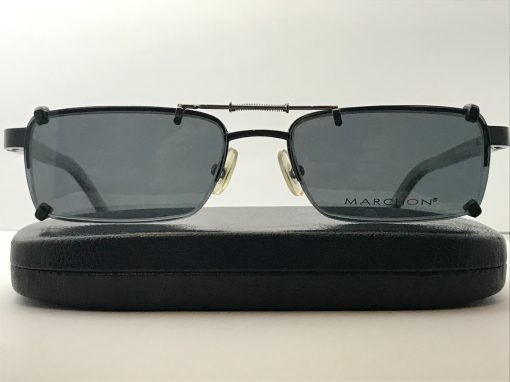 Spring bridge clip on sunglasses with gray lenses over Marchon M722, on top of a case