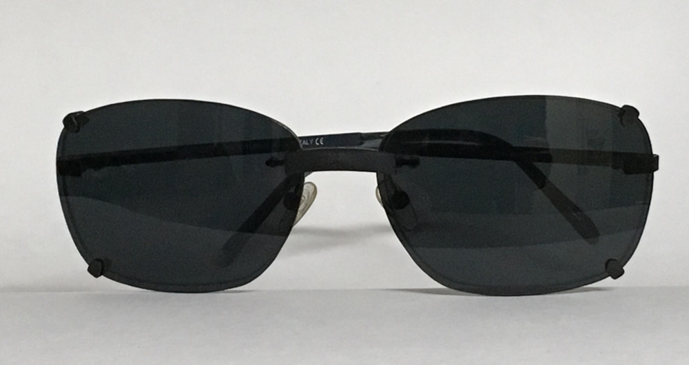Magnetic clip-on sunglasses over rimless spectacles