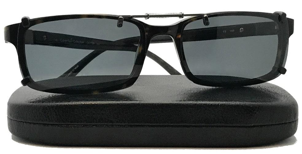 Spring bridge clip on sunglasses with gray lenses over Calvin Klein CK7739, on top of a case