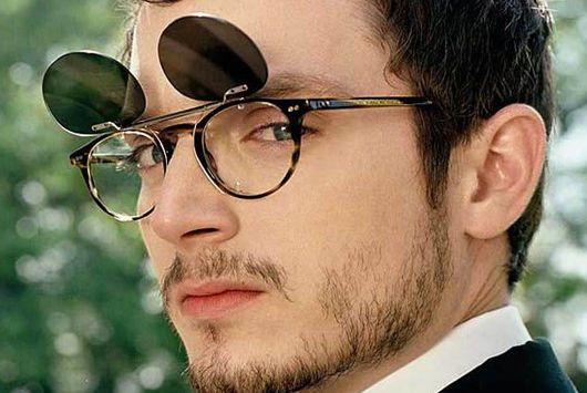 Elijah Wood with flip up clip on sunglasses