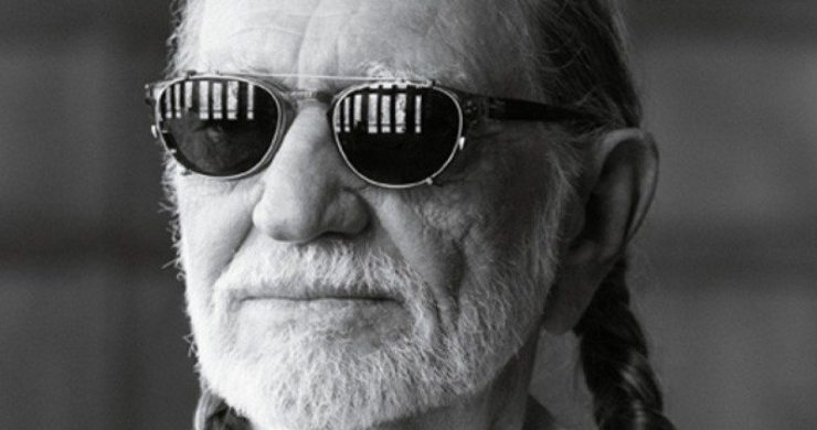 Willie Nelson with clip on sunglasses